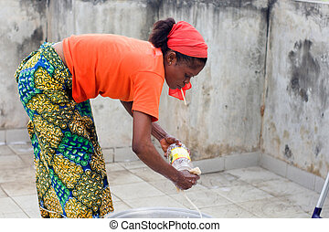 young woman washes dishes