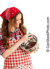 Young woman washing dishes in kitchen over white background