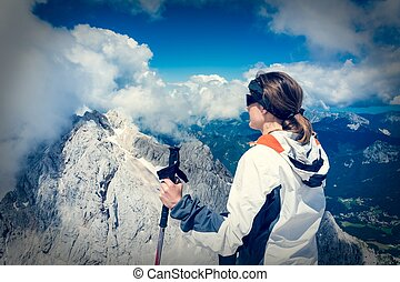 Young woman watching a spectacular view - Young woman ...