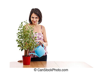 Young woman watering