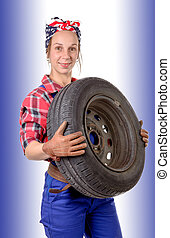 young woman wearing a mechanic car wheel