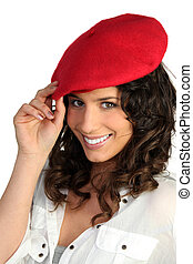 young woman wearing a red beret
