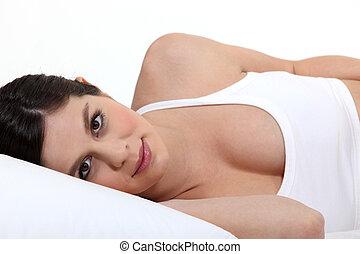 Young woman wearing a sports bra