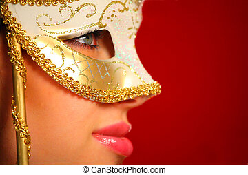 Young woman wearing a venetian mask