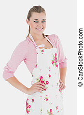 Young woman wearing apron