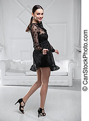 Young woman wearing ? black