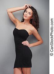 Young woman wearing black evening dress