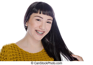Young woman wearing braces on white background - Cute...