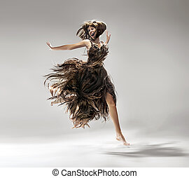 Young woman wearing dress made of hair - Young lady wearing...