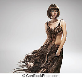 Young woman wearing dress made of hair