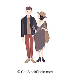 Young woman wearing fashionable poncho and hat standing beside smiling man, holding his arm and warmly looking at him. Elegant teenage couple. Pair of cartoon characters. Vector illustration.