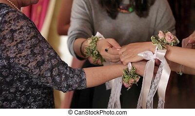 Young woman wearing flowers bracelet for celebration