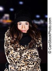 Young woman wearing fur.