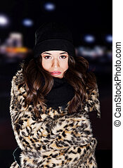 Young woman wearing fur.