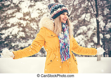 Woman wearing hat and scarf happy
