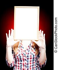 Young woman wearing plaid shirt holding empty frame