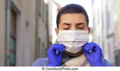 young woman wearing protective face mask in city - health, ...