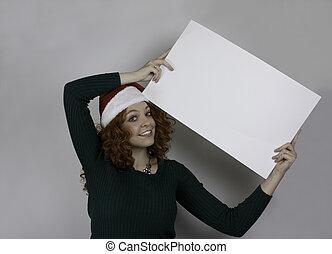 Young woman wearing Santa hat