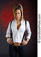 Young woman wearing sexy clothes with suspenders