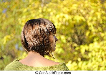 Young woman wearing short bob hairstyle.