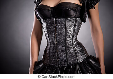 Young woman wearing silver corset with stars