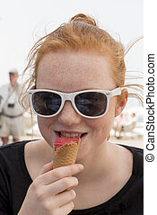Young Woman Wearing Sunglasses Eating Ice Cream