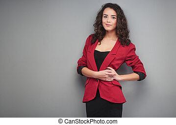 Young woman wearing vinous jacket