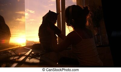 Young woman wears headphones and relaxing with her lovely...
