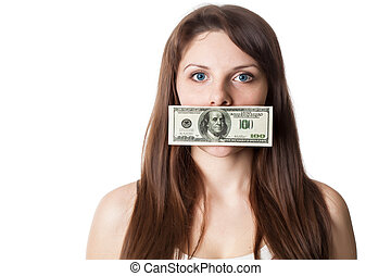 Young woman with 100 dollar bill on her lips. Studio shot. ...