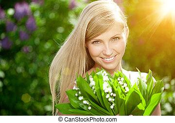 Young woman with a beautiful smile with healthy teeth with...