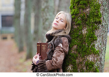 Young woman with a Bible