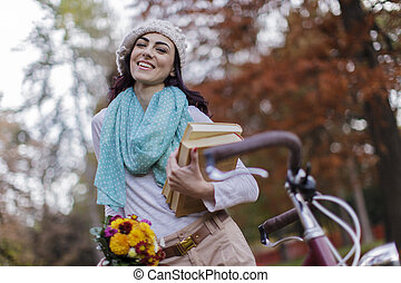 Young woman with a bicycle