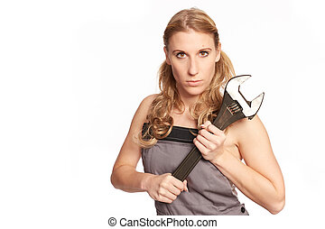 Young woman with a big wrench