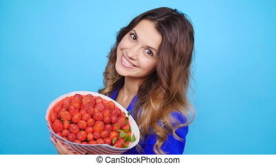 Young woman with a bouquet of strawberries