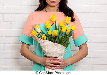 young woman with a bouquet of tulips, Close-up