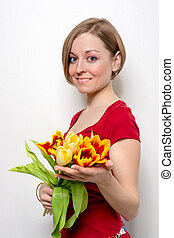 Young woman with a bouquet of tulips
