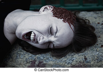 Young woman with a broken head in the blood