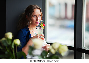 Young woman with a cocktail