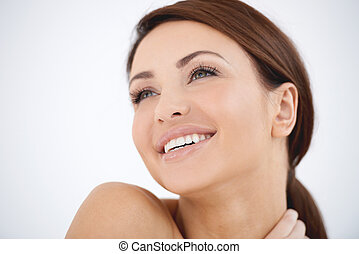 Young woman with a dreamy happy expression
