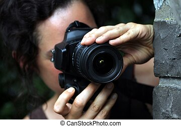 young woman with a dslr camera