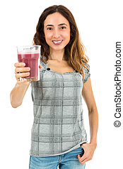 Young woman with a glass of smoothie