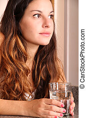 Young woman with a glass of water