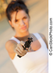 Young woman with a gun