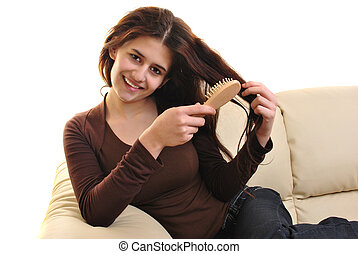 young woman with a hair brush in her hand