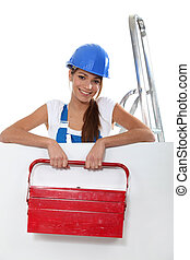 Young woman with a large toolbox and a board left blank for your image