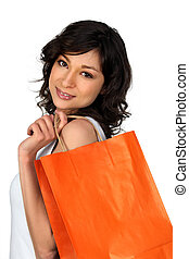 Young woman with a luxury store bag