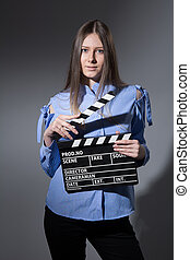 Young woman with a movie clapper