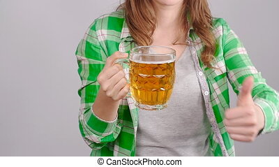 Young woman with a mug of beer