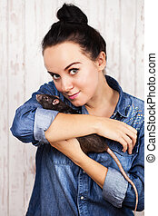 Young woman with a pet rat