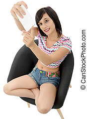 young woman with a phone makes a selfie, on white